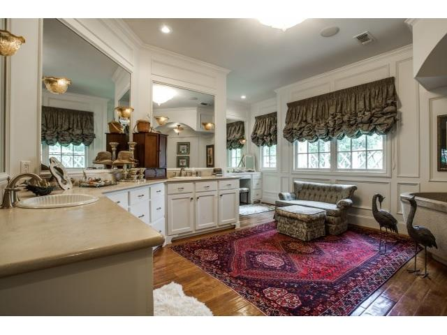 Luxurious master bath with enormous tub, separatevanities.