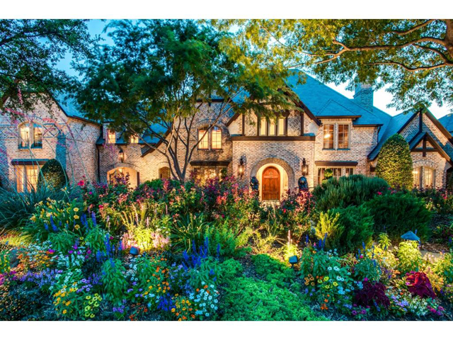 Nestled among hundred year old oaks, gently tucked in by lush ma