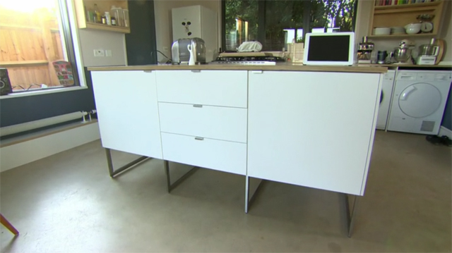 Cabinetry floating on legs appears to increase floor space