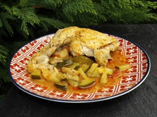 Cuisses de poulet à la tomate et aux courgettes