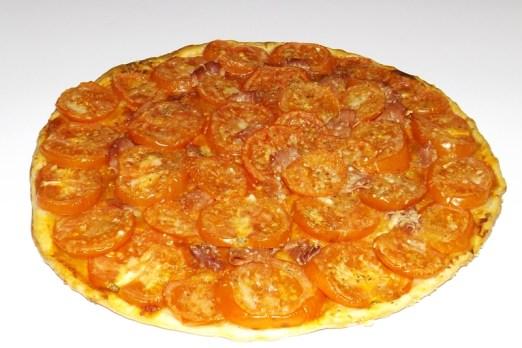 Tarte aux tomates, au jambon de Parme et au Parmigiano Reggiano