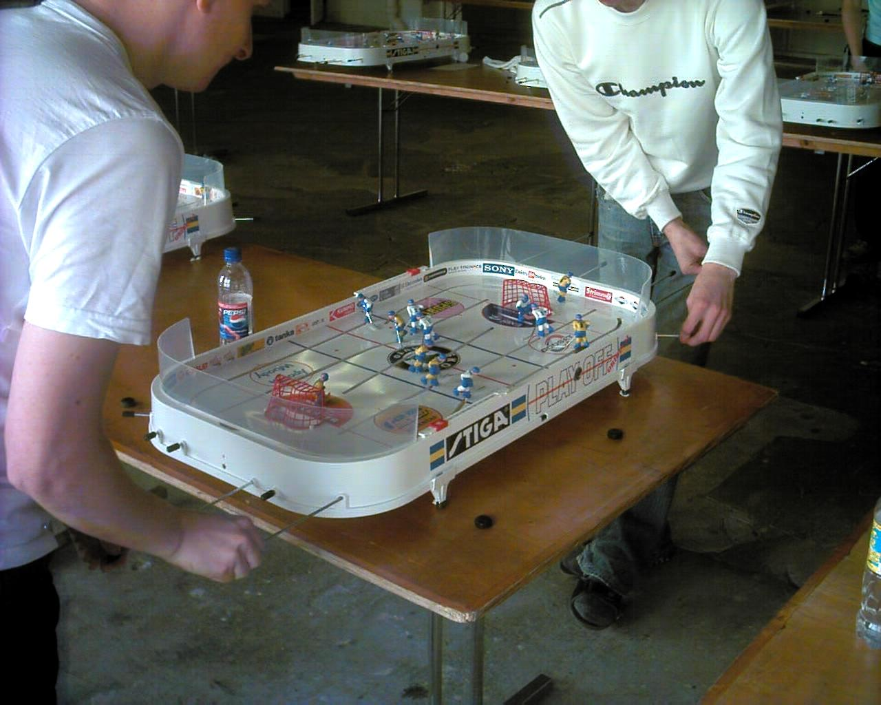 Two men playing a game of Table Hockey