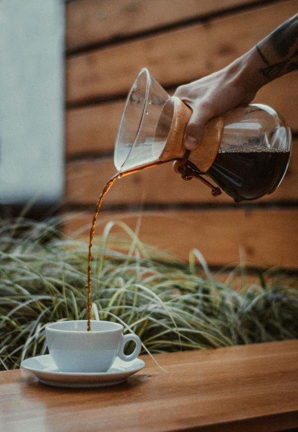 person-pouring-coffee-on-a-mug-3473488