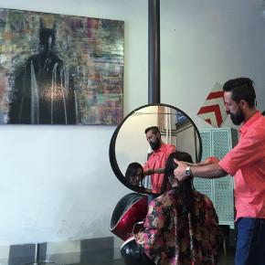 Girl gets a hair cut by DeepCut Istanbul's stylist Ugur under Batman's watch