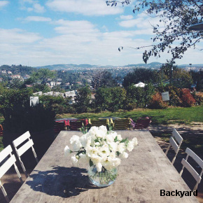 Wooden table with flowers in Backyard's beautiful garden