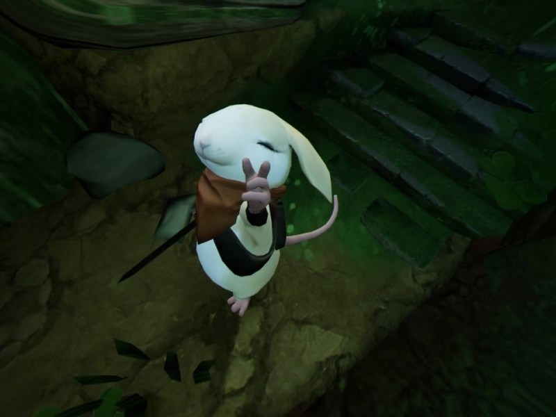 Close-up of Moss, ears back, eyes closed, pointing up at player character.