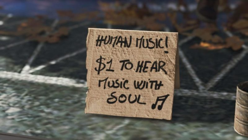 """Close-up of cardboard sign, """"Human Music! $1 to hear music with soul."""""""