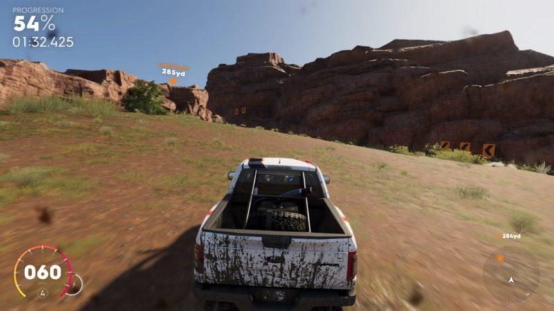 Pickup truck racing through canyons