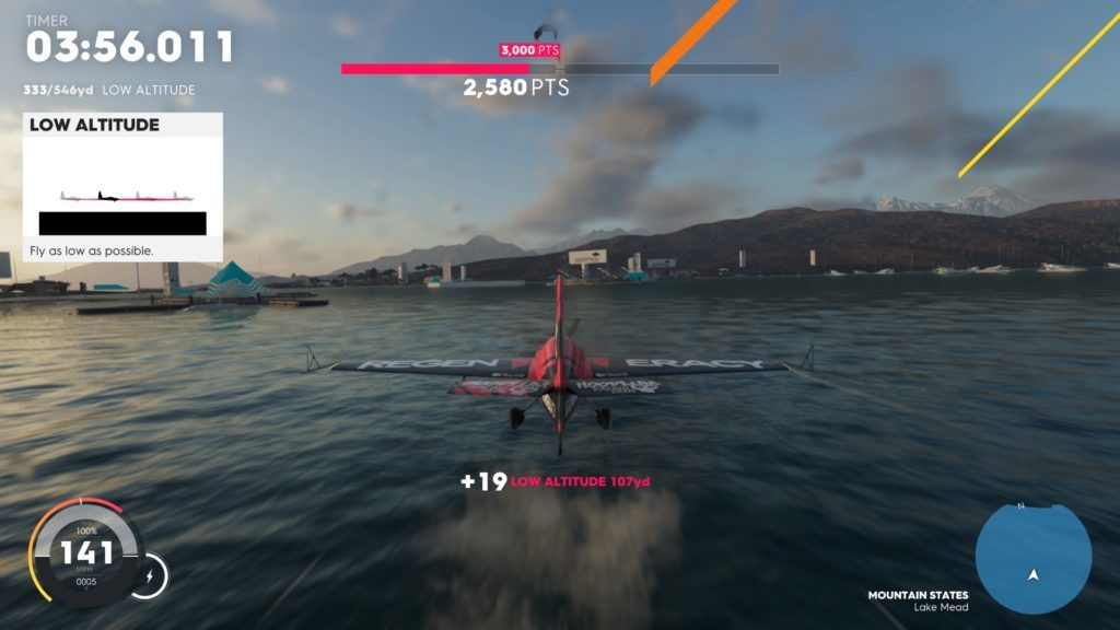 Small plane flying low over water