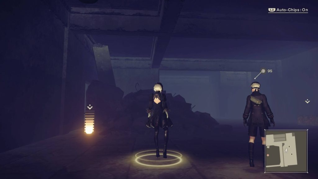 2B and 9S inside dark building.