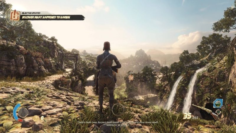 Player character standing near a cliff surveying mission area.