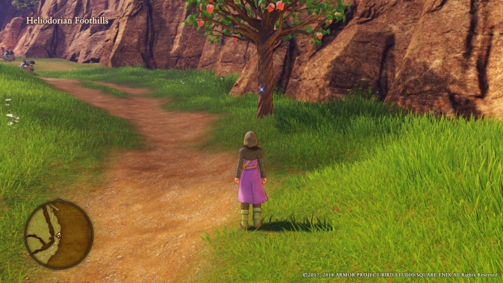 Character standing on path, tree with collectible item shown in distance.