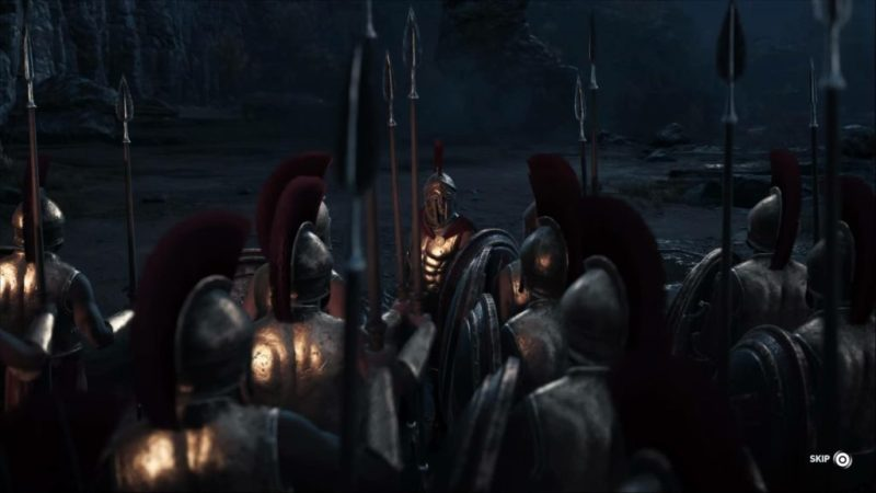 Leonidas addressing a group of soldiers in armor with spears.