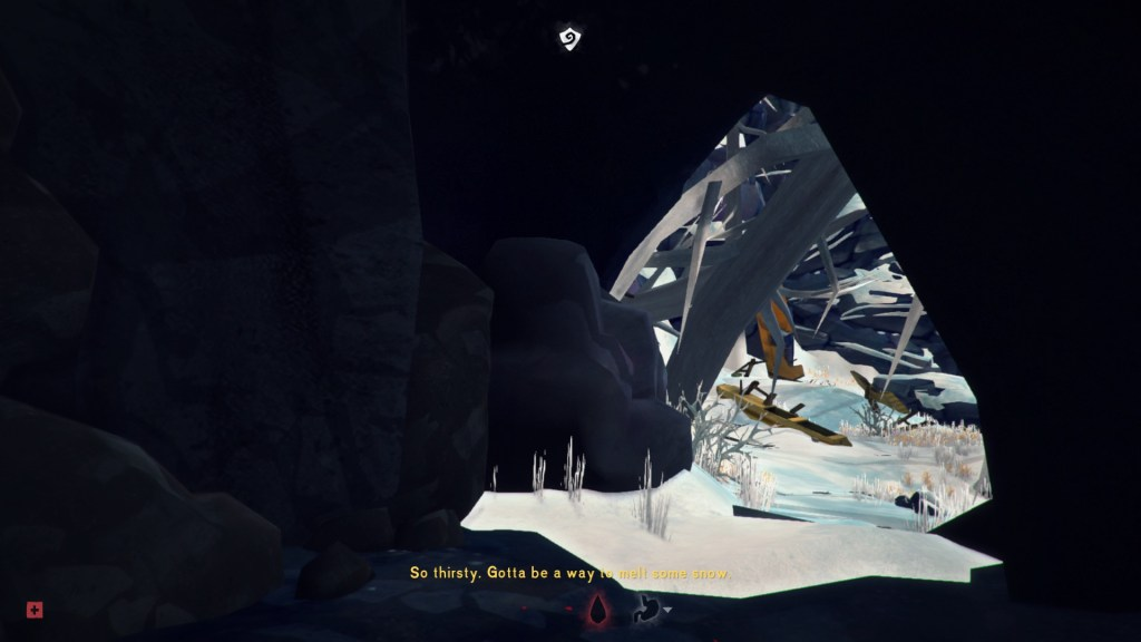 Inside cave, thirst icon showing at bottom of screen with subtitles half legible against cave background, half illegible against snow.