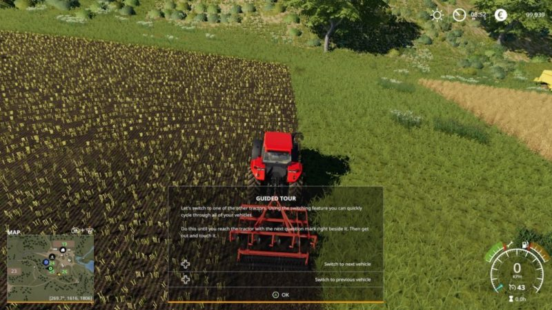 Top down view of red sowing tractor and empty field.