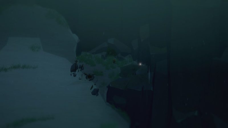 Dark beach in tutorial area of Below with collectible item glowing on center-right side of screen.