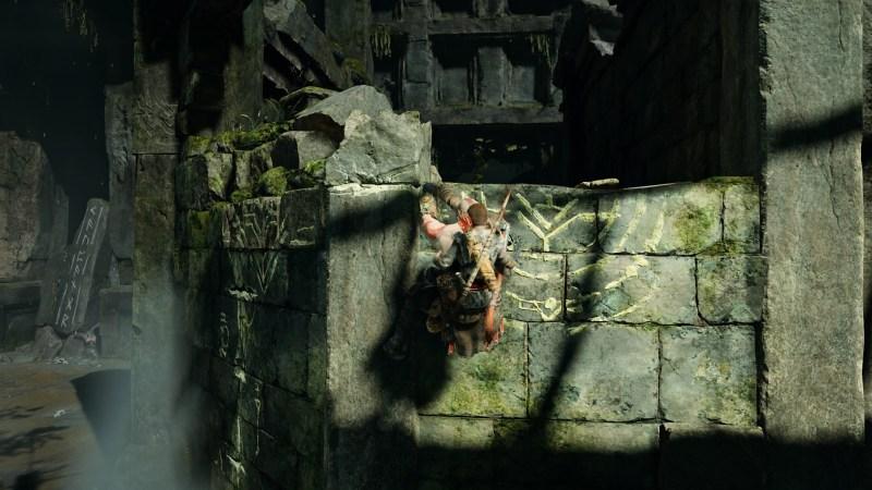 Kratos and Atreus climbing a stone wall