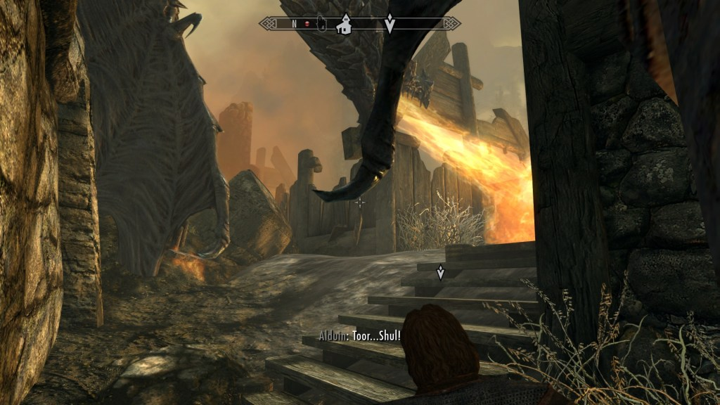Dragon standing above player character, breathing fire in Helgen.