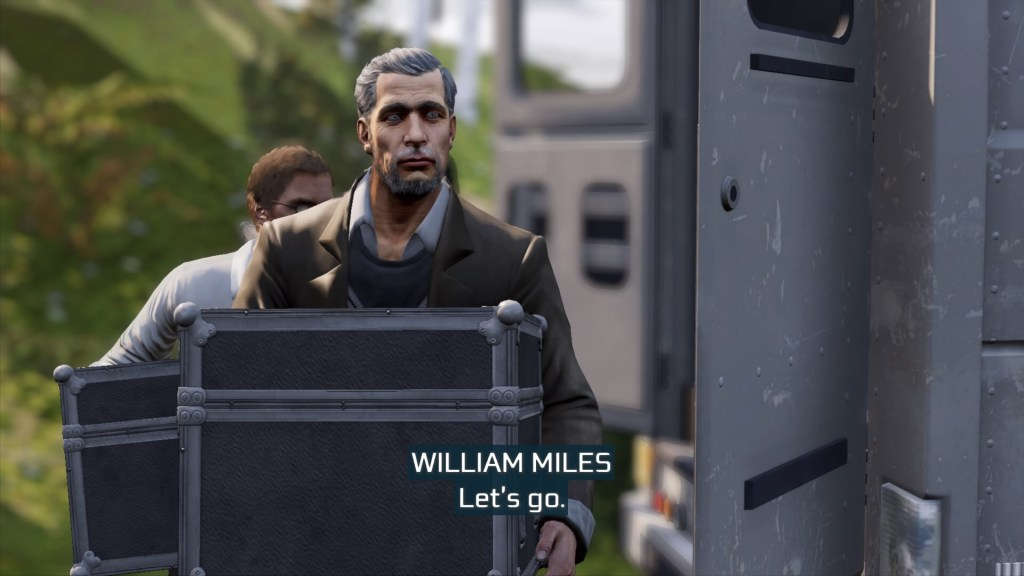 William and Desmond Miles walking carrying crates.