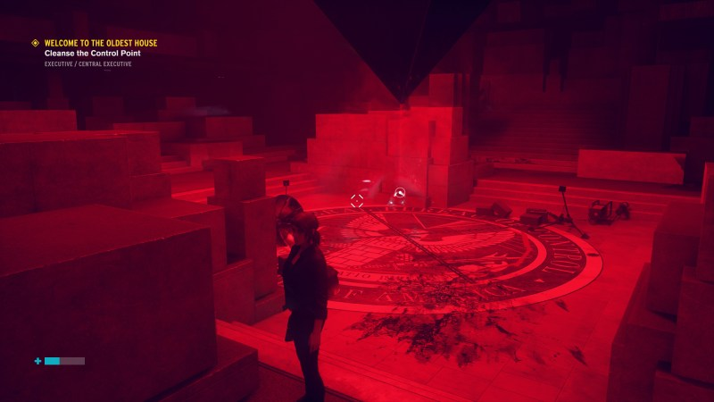 Jesse standing in a large red tinted room.