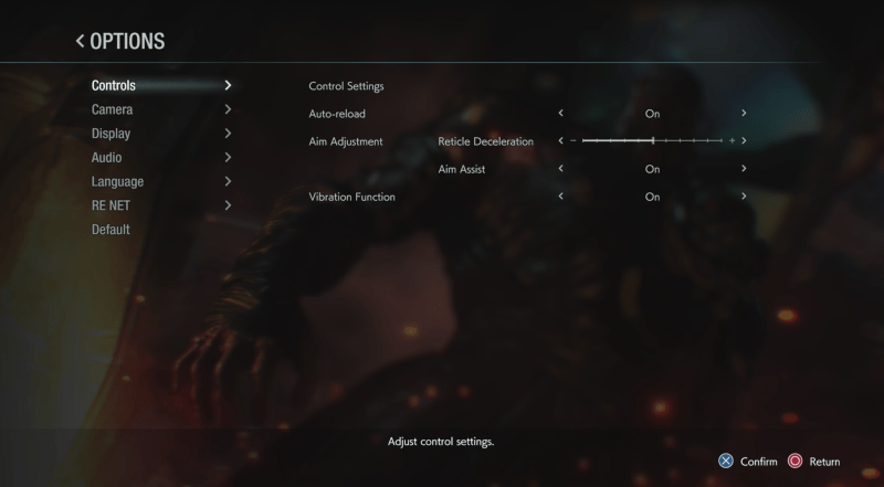 Resident Evil 3 Control Settings Menu - Options include: Control Settings as a sub menu, Auto-reload set to On, Aim Adjustment Reticle Deceleration set to 50%, Aim Adjustment Aim Assist set to On, Vibration Function set to On