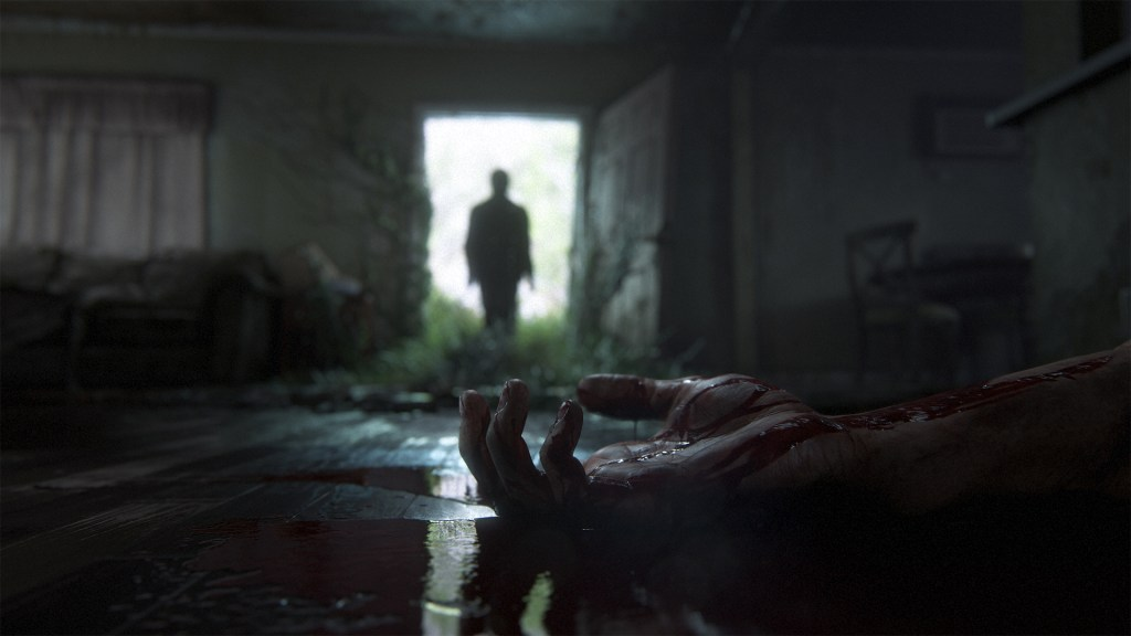The Last of Us 2 - Ellie in the background, a corpse hand in foreground