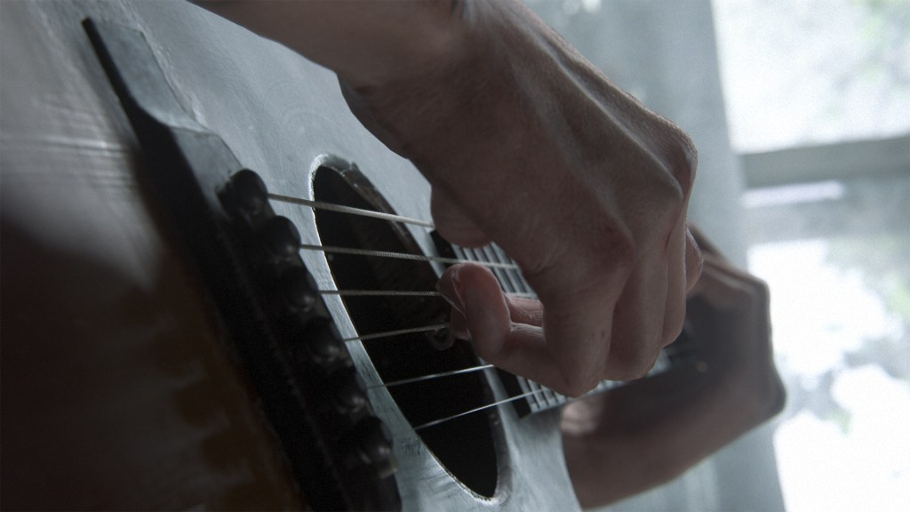 The Last of Us 2 - Close up of Ellie's hands playing a guitar