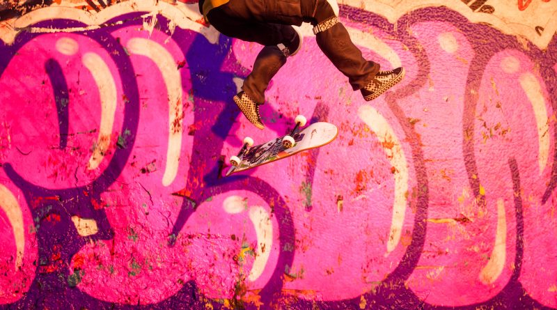 Tony Hawk's Pro Skater 1+2 feature image of skater flip tricking near a wall with pink graffiti