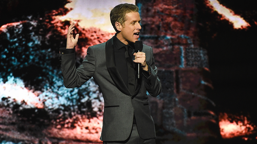 The Game Awards 2019 show with Geoff Keighley speaking into a microphone