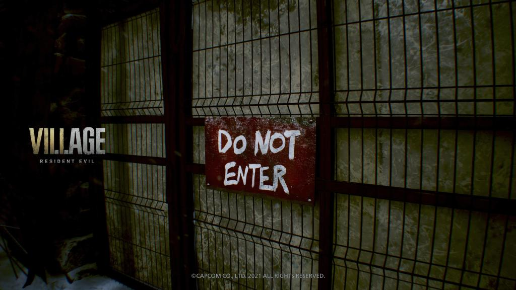 """Resident Evil Village logo and a gate marked with a """"do not enter"""" sign."""