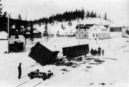 A photograph of the Oskaloosa Hotel, seen above the derailed train car, was built on Mineside in 1893; it was torn down in about 1920. This photograph was used in Edna Appleby's book Canmore: Story of an Era.
