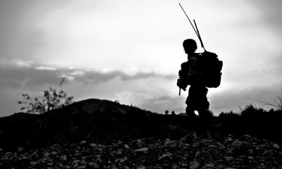 A soldier on a black and white background