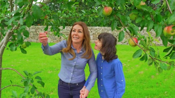 Charlotte Caldwell picks apples with her son Billy.