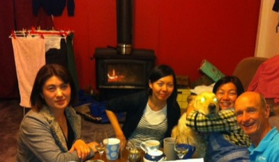 Guests enjoying dinner in front of the fire.