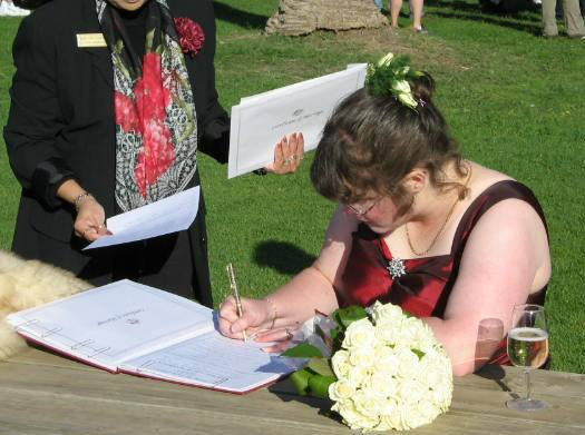 The Bride  Signing the Marriage Register