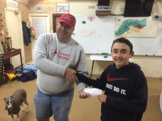 Tuesday 11th August 2015 : Club member Jamie Ingram presenting tonights winner Luke Egger with a movie voucher