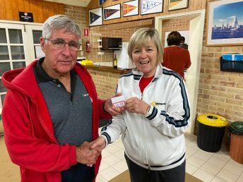 Tuesday 8th September 2020 : Tonight's photo shows club member Judith Thompson presenting tonight's winner Joe Wilson with Club Money.