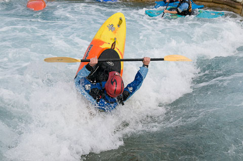 Kayaker gets flipped by a wave at the Lee Valley Legacy course.