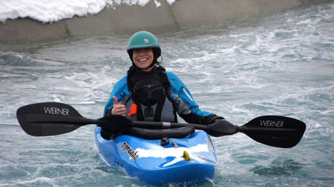 Kayaker smiles in their kayak on the Legacy course