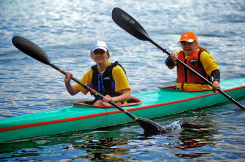 Canoeing for disabled people. Two kayakers paddle a kayak as part of the Special Olympics.
