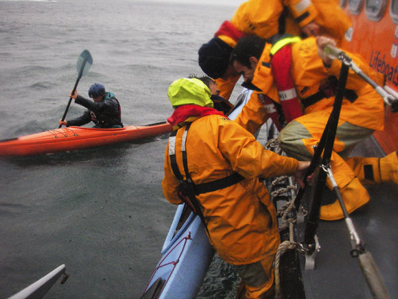 RNLI lifeboat crew respond to a sea kayaker in difficulty