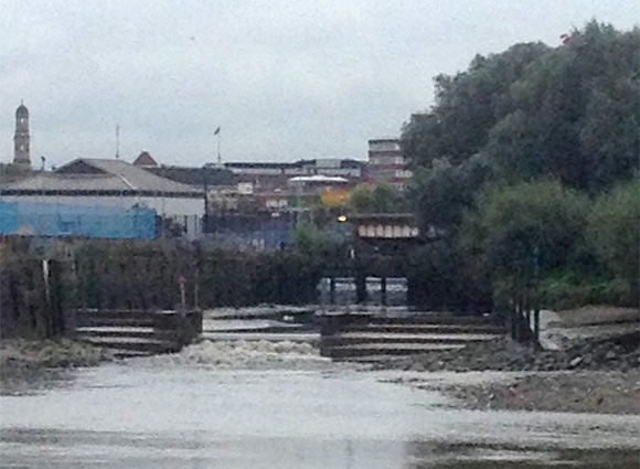 The River Wandle meets the Thames at low tide.