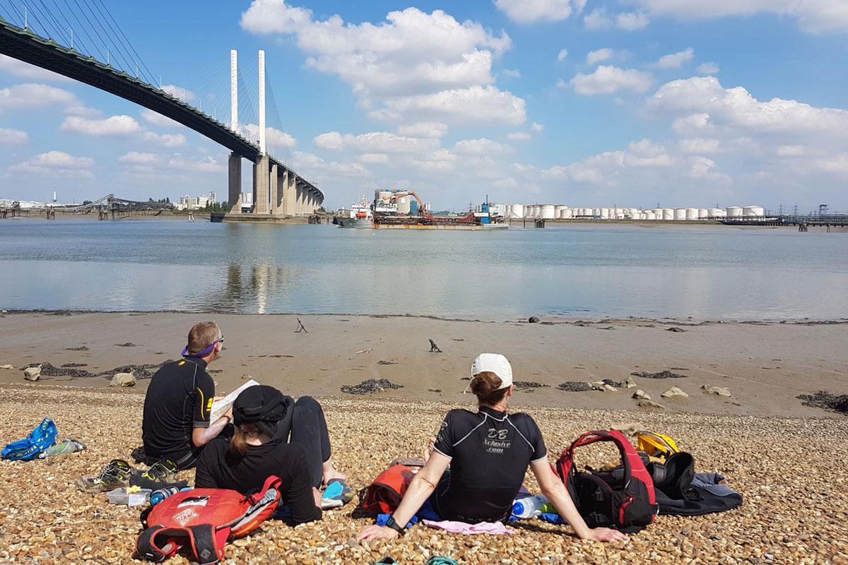 Kayaking lunch stop below the Queen Elizabeth II Bridge on Thames Estuary