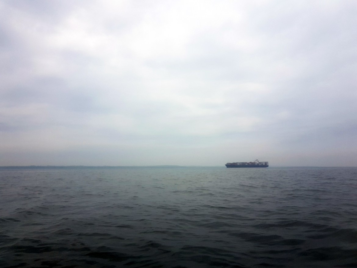 A large container ship travelling past Canvey Island