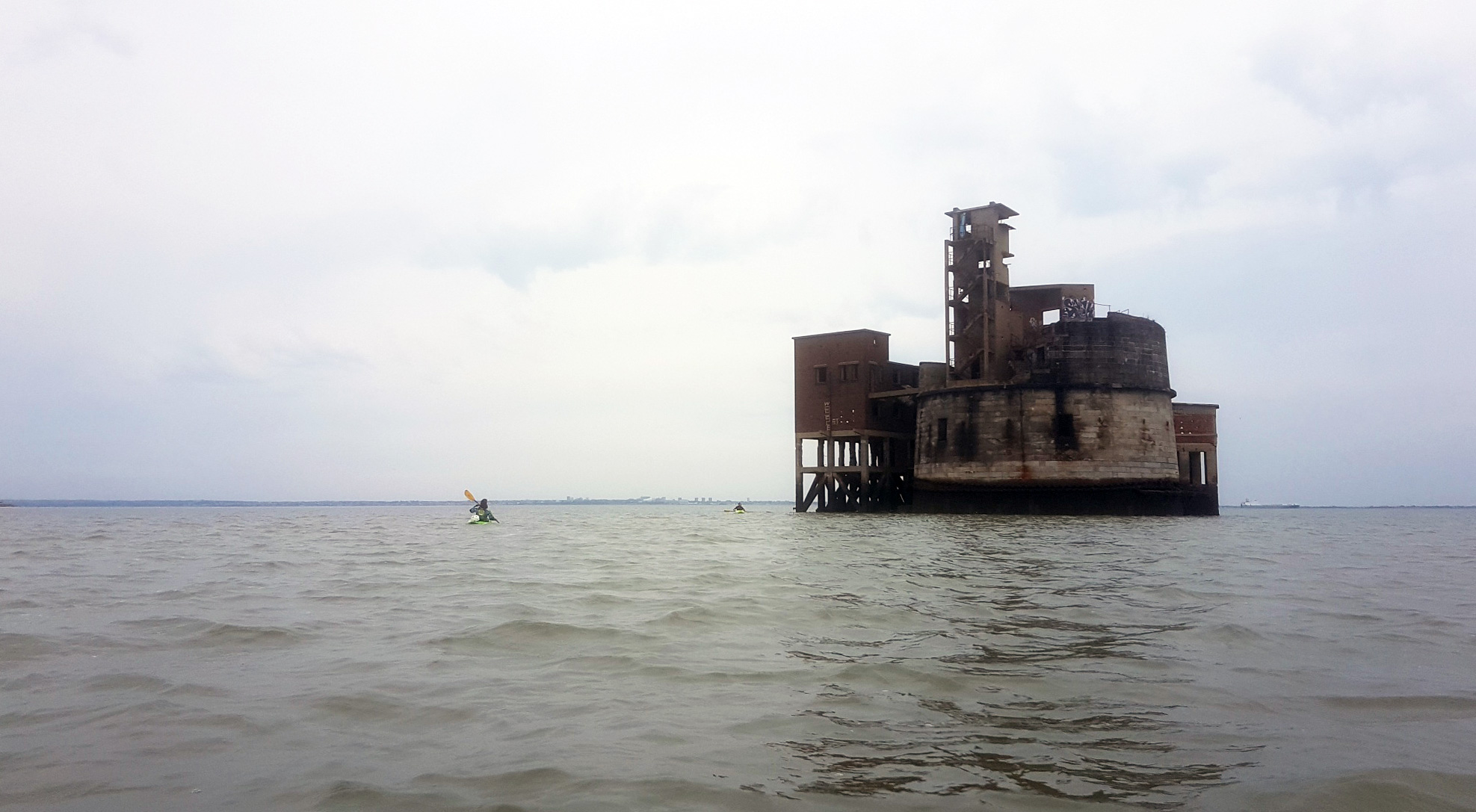 Kayakers approach Grain Tower Battery in the Medway estuary