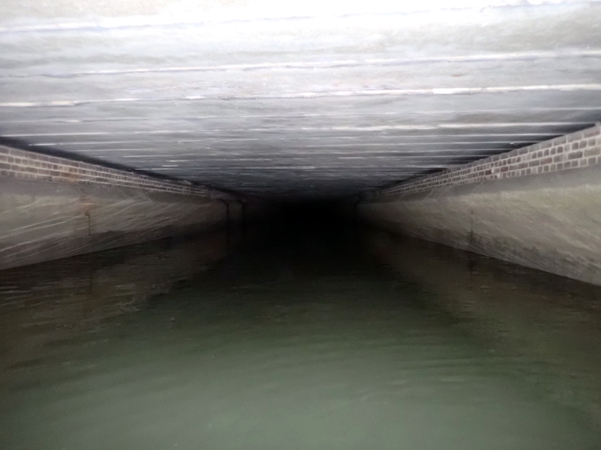 Loxford Water, a dark culvert which disappears under Barking