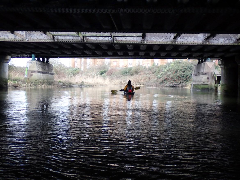 Kayaking below the Barking train bridges