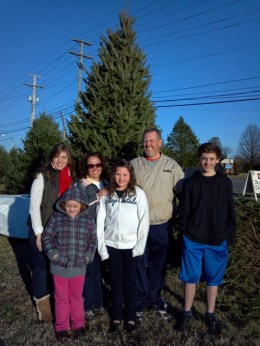 The Phillips Family with their 12' Christmas Tree