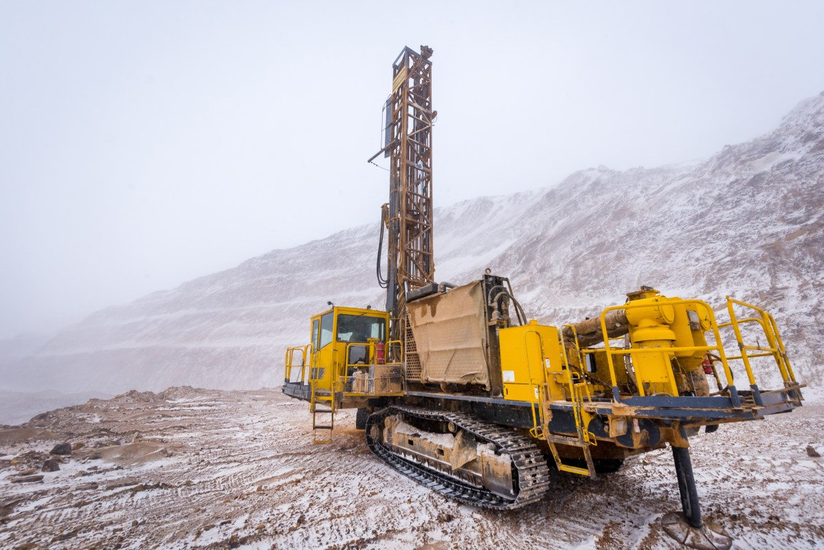 Drilling machine ar a mining career in the winter time