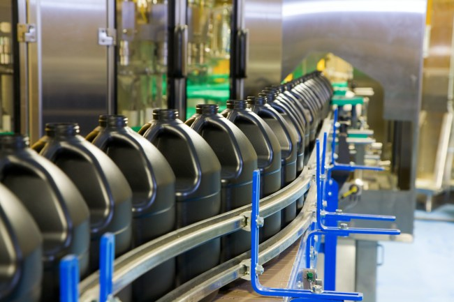 Empty containers are lined up on the conveyor of high-speed fill line